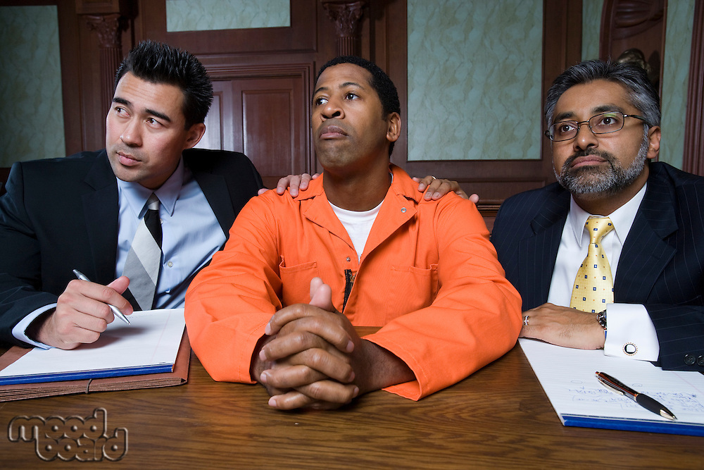 Lawyers with criminal in court