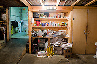 """Harlem, New York, USA - March 29. The """"toolbox"""" of funeral home director Isaiah Owens is in the basement of the funeral home, where the embalming process takes place, on March 29, 2008 in Harlem, New York, USA. His tools include wigs, needles, liquid tissue (botox), oil (for the face), newspaper and make-up."""