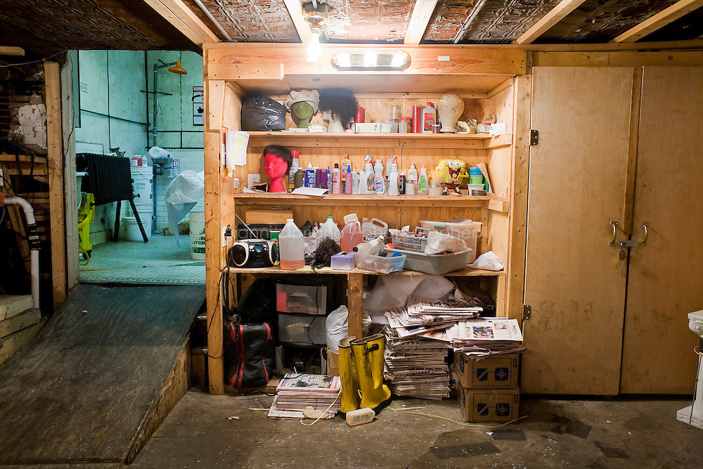 "Harlem, New York, USA - March 29. The ""toolbox"" of funeral home director Isaiah Owens is in the basement of the funeral home, where the embalming process takes place, on March 29, 2008 in Harlem, New York, USA. His tools include wigs, needles, liquid tissue (botox), oil (for the face), newspaper and make-up."
