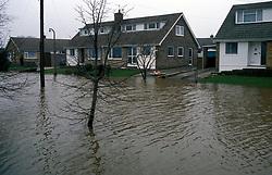 Flooded street in residential area of York UK