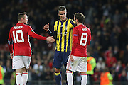 Wayne Rooney Forward of Manchester United with Juan Mata Midfielder of Manchester United and Fenerbahce Forward Robin van Persie during the Europa League match between Manchester United and Fenerbahce at Old Trafford, Manchester, England on 20 October 2016. Photo by Phil Duncan.