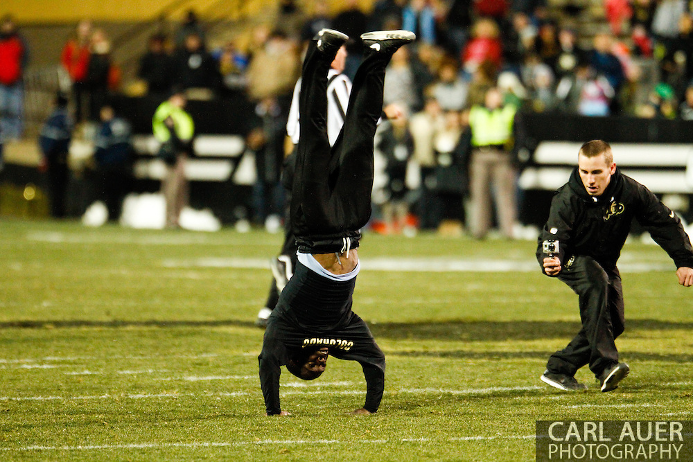 November 23rd, 2013:  Colorado Cheerleader sets a new world record with 59 back flips between the first and second quarter of action in the NCAA Football game between the University of Southern California Trojans and the University of Colorado Buffaloes at Folsom Field in Boulder, Colorado