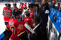 PENTICTON, CANADA - SEPTEMBER 8: Matthew Phillips #47 of Calgary Flames receives direction from assistant coach Domini Pittis on the bench against the Edmonton Oilers on September 8, 2017 at the South Okanagan Event Centre in Penticton, British Columbia, Canada.  (Photo by Marissa Baecker/Shoot the Breeze)  *** Local Caption ***