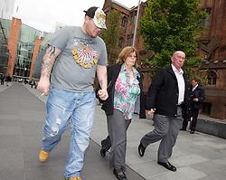 © Licensed to London News Pictures. 23/07/2011. Manchester, UK. L to R Tim Papworth (Rebecca Leighton's fiance) and a couple believed to be Rebecca Leighton's parents leaving Manchester Magistrates' Court today (23/07/2011) following the nurse's court appearance. 27 year old Rebecca is charged with with six counts of causing damage with intent to endanger life in connection with five deaths at Stepping Hill Hospital in Stockport. Photo credit : Joel Goodman/LNP
