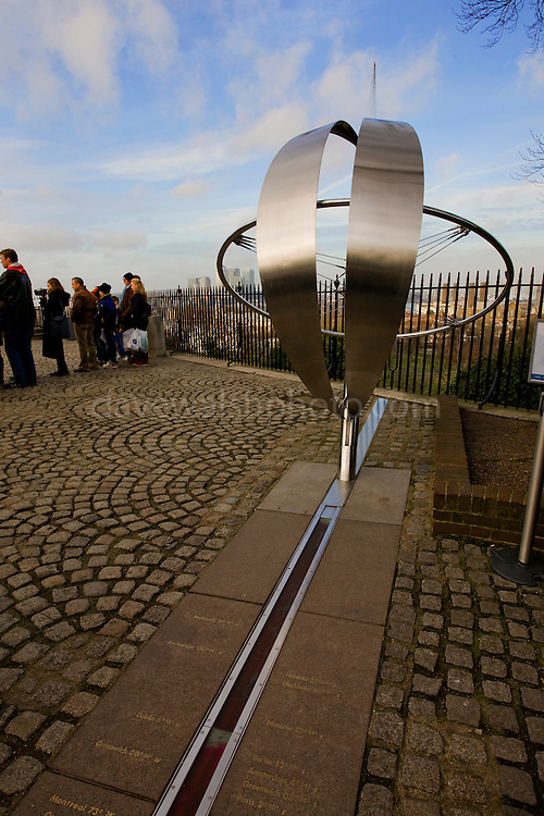 Greenwich Prime Meridian at the Royal Observatory, where the western and eastern hemispheres are arbitrarily divided, has a longitue of 0, zero. The marker line runs through the grounds of the Observatory, in London.