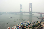 INDONESIA, Palembang : 29 October 2015 Ampera Bridge above Musi River surrounded by a thick haze from forest fires which shroud the city in Palembang, South sumatra, Indonesia. The haze has blanketed parts of western Indonesia for about two months and affected neighbouring countries like Singapore, Malaysia and Thailand.