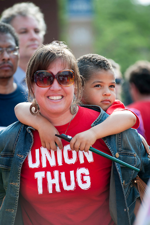 Victoria Gutierrez, a nurse at Madison's Meriter Hospital and member of Service Employee International Union (SEIU), and her son, Julian Miranda, join thousands of firefighters, teachers, public employees and pro-union citizens for a solidarity rally outside the Wisconsin State Capitol in Madison, Wis., on June 14, 2011. The rally is part of continued public protest against efforts by Wisconsin Gov. Scott Walker and the Republican-controlled legislature to enact measures that negatively impact collecting bargaining rights for union workers and the benefits of public employees. In addition, state funding and support is being cut from the state budget for many programs related to education, healthcare and senior care. (Photo by Jeff Miller for SEIU)