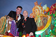 Actor Bryan Batt and Louisiana's Lieutenant Governor Mitch Landrieu ride on a float in the Krewe of Orpheus Mardi Gras parade