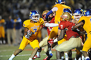 Lafayette High vs. Tupelo's Jarvis Wilson (7) in Oxford, Miss. on Friday, August 22, 2014. Tupelo won the season opener 20-0.