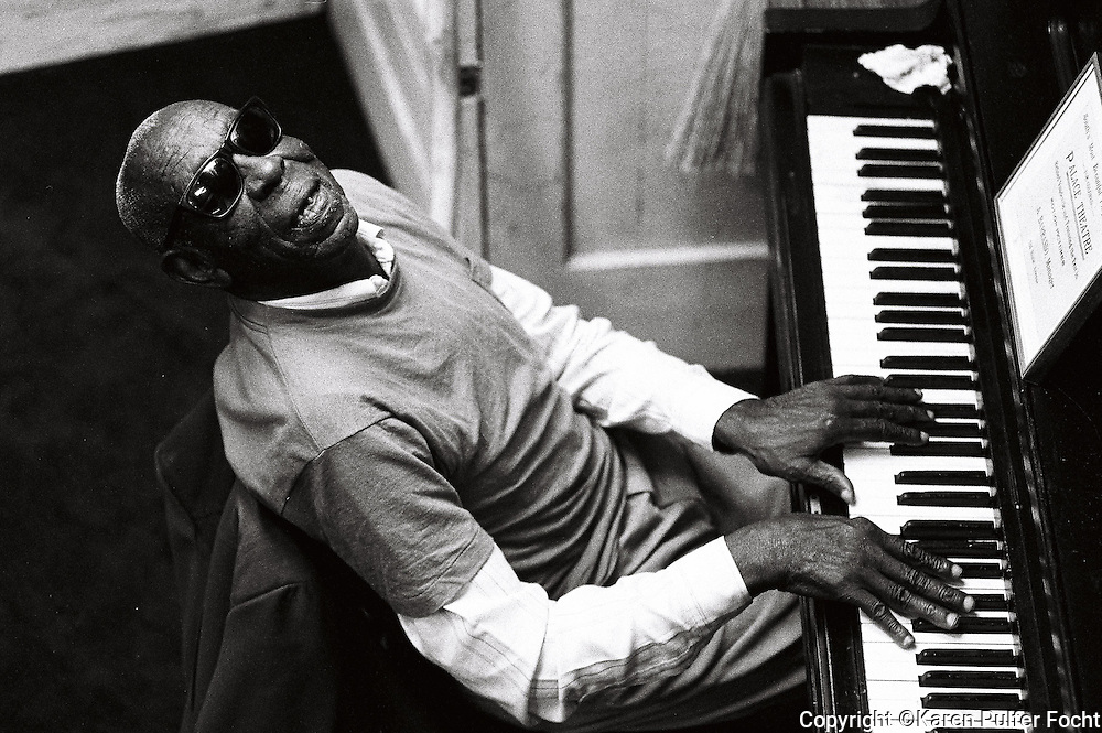 Mose Vinson, a veteran Memphis blues man plays piano on Beale Street.