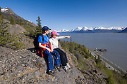 Alaska Turnagain Arm, Chugach State Park Family enjoying a hike together at HcHugh Creek Recreation Area in the Chugach National Forest. Trails offer a great view over Turnagain Arm and the Chugach mountains..