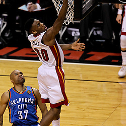 Jun 19, 2012; Miami, FL, USA; Miami Heat point guard Norris Cole (30) shoots over Oklahoma City Thunder point guard Derek Fisher (37) during the second quarter in game four in the 2012 NBA Finals at the American Airlines Arena. Mandatory Credit: Derick E. Hingle-US PRESSWIRE