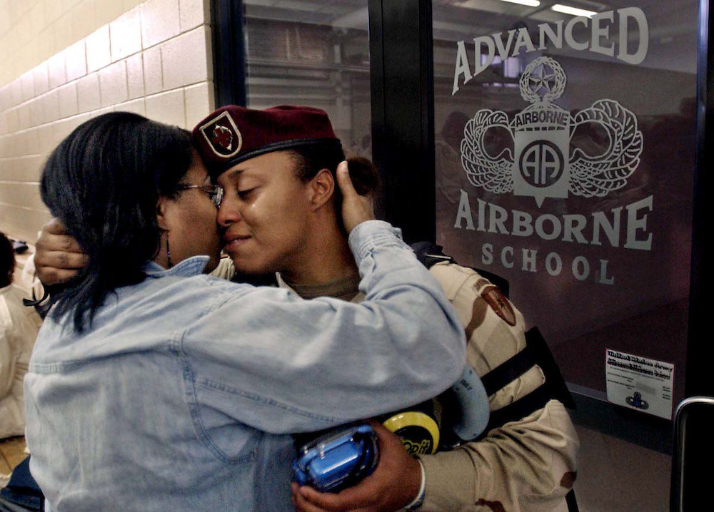 Spc. Shekia Boggan with the 44th Medical Command, right, and her mother Carolyn Anthony say their last goodbye at the green ramp att Pope Air Force Base Friday, Nov. 12, 2004. The 44th Medical Command are deploying for Iraq.