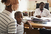 Dr. Denise Mobio meets with Kadidiatou Sy, 27, and her son Junior Karampire, 5, who suffers from recurring ear infections, at the Koumassi General Hospital in Abidjan, Cote d'Ivoire on Friday July 19, 2013.
