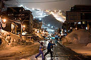 With the lights of Grand Hirafu ski resort in the distance, boarders and skiers cross the main street at Hirafu, Japan on Feb. 7 2010. Many of Niseko's 57 ski runs are open until 9 p.m., making Niseko the biggest supplier of night skiing in the world.