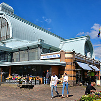 Saluhallen or The Market Hall in Gothenburg, Sweden <br /> Stora Saluhallen is the largest indoor marketplace in Gothenburg. This is the place to go for a quick bite to eat for lunch or to shop for fresh fish, meat, cheese, bread, produce, fruits, spices and so much more. All forty stalls are piled high with tempting food. Since 1889, The Market Hall&rsquo;s generous policy has been that the tempting aromas are free. Surrounding it is Royal Square. From 1847 until the mid-1870s, this was the location of the city&rsquo;s only outdoor market.