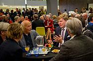 15-11-2017 - Koning Willem Alexander is woensdag 15 november 2017 aanwezig bij een feestelijke bijeenkomst ter gelegenheid van het 50-jarig bestaan van de gemeente Lelystad.In het stadhuis vindt een bijeenkomst plaats met de eerste bewoners van Lelystad. Naast een toespraak van de Lelystadse burgemeester, mevrouw I.R. Adema, spreekt de Koning met de pioniers en wordt een gedenkteken onthuld ter gelegenheid van het 50-jarig bestaan van Lelystad. Voorafgaand aan het bezoek in het stadhuis wordt de Koning verwelkomd door kinderen van diverse basisscholen. Zij presenteren de vlaggen die gemaakt zijn om de verjaardag van de stad te vieren. copyright robin utrecht  <br /> <br /> 15-11-2017 - the King Willem Alexander will be present on Wednesday 15 November 2017 at a festive gathering on the occasion of the 50th anniversary of the municipality of Lelystad.In the town hall a meeting will take place with the first inhabitants of Lelystad. In addition to a speech from the Lelystad mayor, Ms I.R. Adema, the King speaks with the pioneers and reveals a memorial on the occasion of the 50th anniversary of Lelystad. Prior to the visit in the town hall, the King is welcomed by children from various primary schools. They present the flags that were made to celebrate the city's birthday. copyright robin utrecht