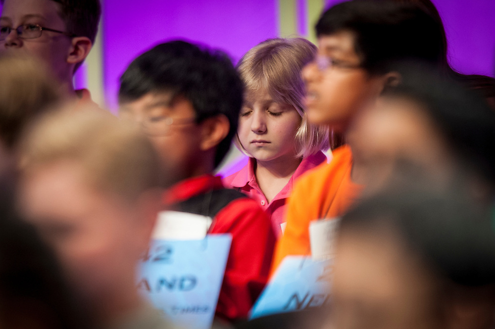 LORI ANNE C. MADISON, 6, of Woodbridge, VA, reacts after missing a word in round three of the 85th Annual Scripps National Spelling Bee at the Gaylord National Resort & Convention Center in National Harbor, Md., near Washington, D.C. Madison is the youngest ever participant in the National Spelling Bee.