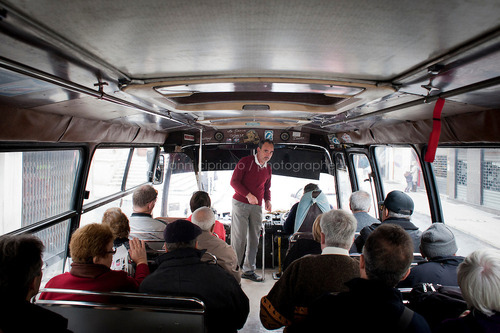 27 February 2011. Medina, Malta. A man gets on the n.81 bus going from Valletta to Medina, a medieval town located in the centre of island, 8 miles from Valletta.<br /> These buses, some of which are 60 years old, will be replaced in the following months by newer buses. There are approximately 500 buses in public transit service in Malta. The drivers themselves own most of the buses, but operate to a unified timetable set by the transport authority.<br /> <br /> &copy;2011 Gianni Cipriano<br /> cell. +1 646 465 2168 (USA)<br /> cell. +39 328 567 7923<br /> gianni@giannicipriano.com<br /> www.giannicipriano.com
