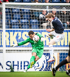 Dundee's keeper Kyle Letheren with Falkirk's Blair Alston.<br /> Falkirk 3 v 1 Dundee, 21/9/2013.<br /> &copy;Michael Schofield.