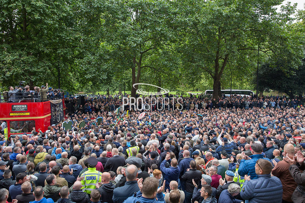 The crowd listen to speeches during the Football Lads Alliance march between Park Lane and Westminster Bridge, London on 7 October 2017. Photo by Phil Duncan.