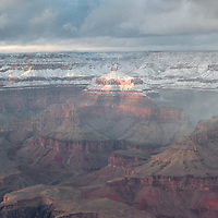 Afternoon light illuminates snow covered formations of the Grand Canyon, Yavapai Point.