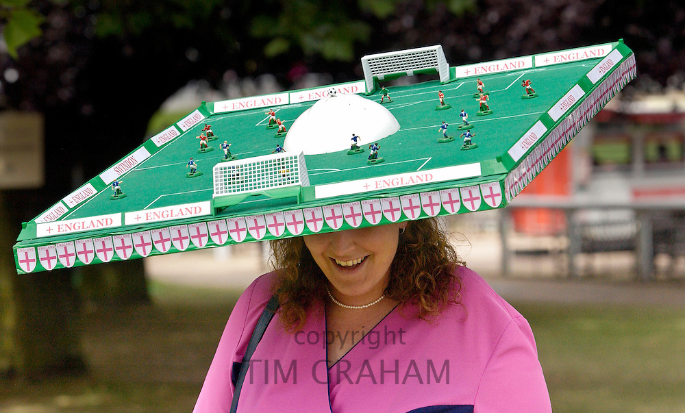 Race-goer wearing a football pitch hat at Royal Ascot Races