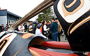 Master carver Moy Sutherland (right) standing with his father Moy Senior (middle) and First Nations people gathered at the Victoria Native Friendship Centre to celebrate the raising of a new 6000 pound totem pole in Victoria, British Columbia Canada on Thursday March 24, 2016. The pole was carved by six Aboriginal Youth working along side Moy Sutherland with the project taking over four and a half months to complete. The theme of the pole is transformation and was part of an empowerment project training youth in the art of traditional carving. (KevinLightPhoto)