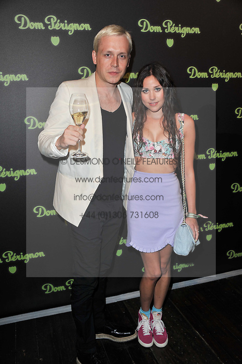 MR HUDSON and ELIZA DOOLITTLE at a party to launch the Dom Perignon Luminous label held at No.1 Mayfair, London on 24th May 2011.