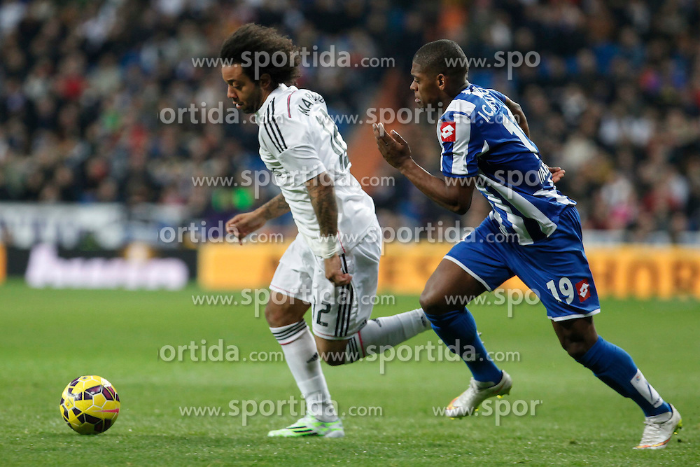 14.02.2015, Estadio Santiago Bernabeu, Madrid, ESP, Primera Division, Real Madrid vs Deportivo La Coruna, 23. Runde, im Bild Real Madrid&acute;s Marcelo Vieira (L) and Deportivo de la Courna&acute;s Cavaleiro // during the Spanish Primera Division 23rd round match between Real Madrid vs Deportivo La Coruna at the Estadio Santiago Bernabeu in Madrid, Spain on 2015/02/14. EXPA Pictures &copy; 2015, PhotoCredit: EXPA/ Alterphotos/ Victor Blanco<br /> <br /> *****ATTENTION - OUT of ESP, SUI*****