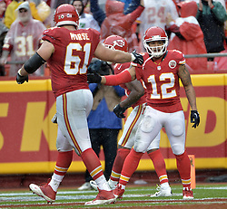 Dec 13, 2015; Kansas City, MO, USA; Kansas City Chiefs wide receiver Albert Wilson (12) is congratulated by center Mitch Morse (61) after Wilson scored during the first half against the San Diego Chargers at Arrowhead Stadium. Mandatory Credit: Denny Medley-USA TODAY Sports