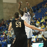Delaware Guard Devon Saddler (10) passes the ball in the second half of a NCAA regular season Colonial Athletic Association conference game between Delaware and The College of Charleston Wednesday, Feb 5, 2014 at The Bob Carpenter Sports Convocation Center in Newark Delaware.
