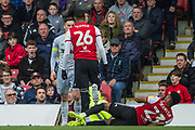Ezri Konsa Ngoyo (Brentford) having an argument with Tom Lawrence (Derby County) while Julian Jeanvier (Brentford) lays on the ground during the EFL Sky Bet Championship match between Brentford and Derby County at Griffin Park, London, England on 6 April 2019.