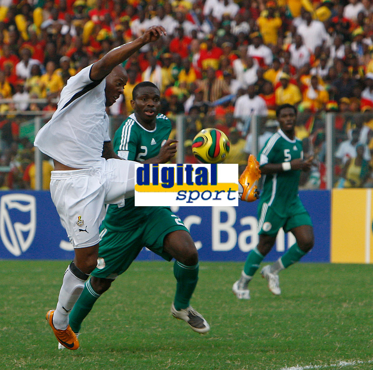 Photo: Steve Bond/Richard Lane Photography.<br />Ghana v Nigeria. Africa Cup of Nations. 03/02/2008. Junior Agogo (L) tries to control a high ball as Joseph Yobo (C) closes in