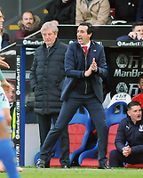 Football - 2018 / 2019 Premier League - Crystal Palace vs. Arsenal<br /> <br /> Arsenal Manager, Unai Emery urges his players on with Palace manager, Roy Hodgson (behind), at Selhurst Park.<br /> <br /> COLORSPORT/ANDREW COWIE