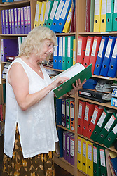 Woman looking at information in file,