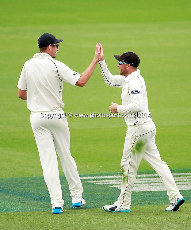 Brendon McCullum of the Black Caps is congratulated by Tim Southee after taking a catch that dismissed the Sri Lankan team on Day 2 of the boxing Day Cricket Test Match between the Black Caps v Sri Lanka at Hagley Oval, Christchurch. 27 December 2014 Photo: Joseph Johnson / www.photosport.co.nz