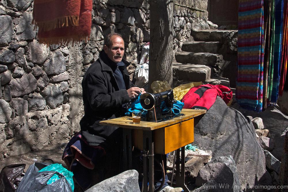 Africa, Morocco, Imlil. Berber Tailor on roadside in Imlil.