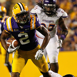 September 10, 2011; Baton Rouge, LA, USA;  LSU Tigers wide receiver Rueben Randle (2) breaks a tackle by Northwestern State Demons safety Cashas Pollard (19) during the second half at Tiger Stadium. LSU defeat Northwestern State 49-3. Mandatory Credit: Derick E. Hingle