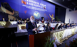 "May 25, 2019 - Valencia, Carabobo, Venezuela - May 25, 2019.  Ruben Dario, deputy minister, in charge of the foreign affairs commission for the peaceful unification of China in Chile, delivers a speech during the opening ceremony of the working plenaries of the conference for the promotion of peaceful reunification of China in a , central and southern America. With the participation of representatives of Chile, Panama, PerÅ"", Curazao, Guatemala, Jamaica, Mexico, Estados Unidos,  Trinity and Tobago- The event was held in the facilities of the Hesperia hotel in the city of Valencia, Carabobo state. Photo: Juan Carlos Hernandez (Credit Image: © Juan Carlos Hernandez/ZUMA Wire)"