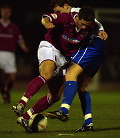 © Peter Spurrier/Sportsbeat Images <br />Tel + 441494783165 email images@sbimages.co.uk<br />06/12/2003 - Photo  Peter Spurrier<br />FA Cup 2nd Rd - Northampton v Weston S Mare<br />Northamptons Marc Richards look is blocked by a Weston defender.