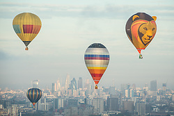 Hot air balloons flying over London during the 2017 RICOH Lord MayorÕs Hot Air Balloon Regatta, which features over 30 balloons launching a flight over London from London City Airport as part of the airport's 30th birthday celebrations