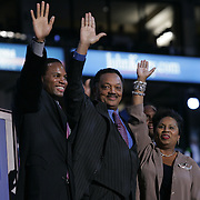 Jesse Jackson and family wave from stage at Democratic convention in Boston. The Reverend Jesse Jackson and his wife Jacqueline are joined by sons Yusef (L) and Jonathan (in the background) on the stage after Jackson's speech during the third session of the Democratic National Convention at the FleetCenter in Boston, July 28, 2004..Photo by Khue Bui