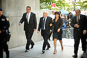 Former IMF chief Dominique Strauss-Kahn arrive the Criminal Courts building on 100 Centre Street along with his wife, Anne Sinclair. Strauss- Kahn pleaded not guilty on Monday to charges he sexually assaulted a New York hotel maid in a case that cost him his job and a chance at the French presidency.