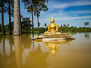 30 SEPTEMBER 2016 - SAI NOI, AYUTTHAYA, THAILAND: A damaged Buddha statue at the flooded Wat Sai Noi in Sai Noi. The Chao Phraya River, the largest river that runs through central Thailand, has hit flood stage in several areas in Ayutthaya and Ang Thong provinces. Villages along the river are flooded and farms are losing their crops due to the flood. This is the same area that was devastated by floods in 2011, but the floods this year are not expected to be as severe. The floods are being fed by water released from upstream dams. The water is being released to make room for heavy rains expected in October.      PHOTO BY JACK KURTZ