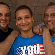 Luis and  his son Joel and his brother Hector a  Hispanic American family portrait outdoors in New York City.