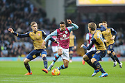 Aston Villa's Scott Sinclair takes on the Arsenal defenders during the Barclays Premier League match between Aston Villa and Arsenal at Villa Park, Birmingham, England on 13 December 2015. Photo by Shane Healey.