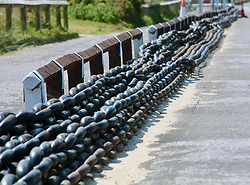 Covid 19 - Redundant chains laid out on the approach road that were used to haul the the Shell Bay to Sandbanks Chain Ferry. A vital service to key workers traveling to Poole/Bournemouth/Christchurch from the Isle of Purbeck Dorset, withdrawn from service for lack of business owing to coronavirus, causing a 22 mile detour. UK April 2020