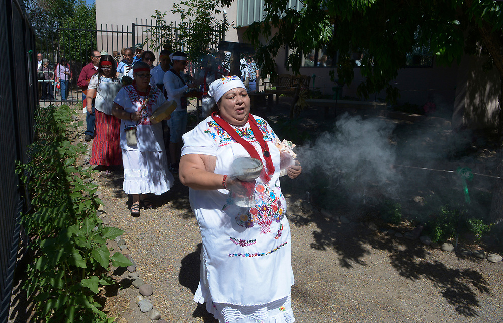 gbs051517c/ASEC -- Tonita Gonzales of Albuquerque leads a procession through the Barelas Senior Center gardens during the 5th Annual El Camino Real Garden Blessing on Monday, May 15, 2017.&nbsp; The tradition is over 400 years old and is celebrated in Spanish speaking countries around the world on the feast of San Isidro, patron of farmers and gardeners.(Greg Sorber/Albuquerque Journal)<br /> &nbsp;