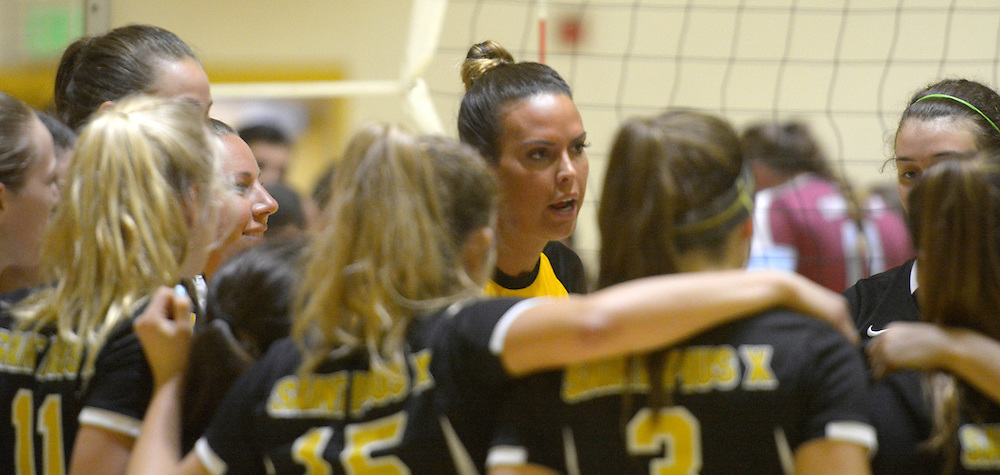 gbs091316m/SPORTS -- St. Pius coach Jeanne Fairchild talks to her players during a time in the game with Sandia Prep at Pius on Tuesday, September 13, 2016. (Greg Sorber/Albuquerque Journal)